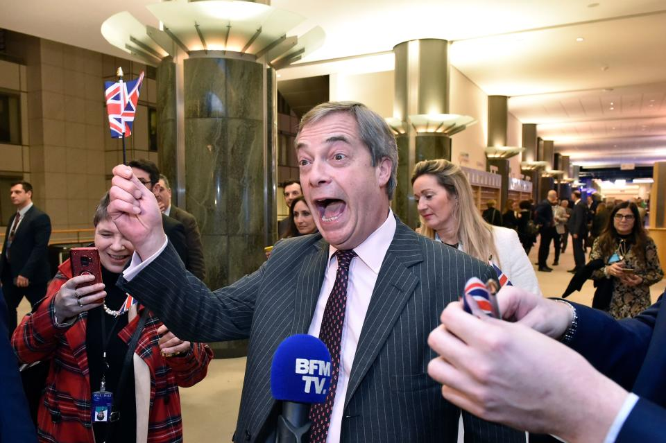 Britain's Brexit Party leader Nigel Farage waves a Union flag as he speaks to the press after the European Parliament ratified the Brexit deal in Brussels on January 29, 2020. - The European Parliament on January 29 voted overwhelmingly to approve the Brexit deal with London, clearing the final hurdle for Britain's departure from the EU. (Photo by JOHN THYS / AFP) (Photo by JOHN THYS/AFP via Getty Images)