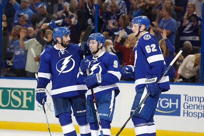 TAMPA, FL - APRIL 30: Tyler Johnson #9 of the Tampa Bay Lightning celebrates his empty net goal with teammates Jason Garrison #5 of the Tampa Bay Lightning and Andrej Sustr #62 of the Tampa Bay Lightning during the third period in Game Two of the Eastern Conference Second Round during the 2016 NHL Stanley Cup Playoffs at Amalie Arena on April 30, 2016 in Tampa, Florida. Scott Iskowitz/Getty Images/AFPTAMPA, FL - APRIL 30: Tyler Johnson #9 of the Tampa Bay Lightning celebrates his empty net goal with teammates Jason Garrison #5 of the Tampa Bay Lightning and Andrej Sustr #62 of the Tampa Bay Lightning during the third period in Game Two of the Eastern Conference Second Round during the 2016 NHL Stanley Cup Playoffs at Amalie Arena on April 30, 2016 in Tampa, Florida. Scott Iskowitz/Getty Images/AFP (AFP Photo/Scott Iskowitz)