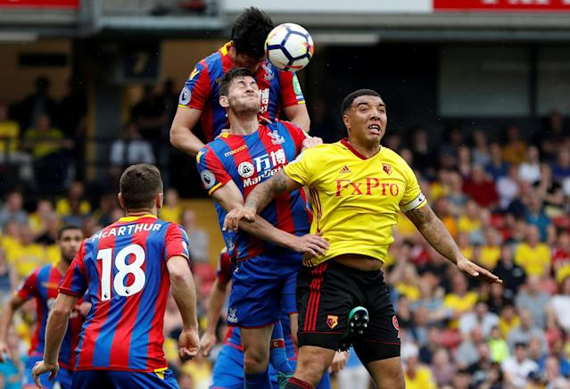 """Soccer Football - Premier League - Watford v Crystal Palace - Vicarage Road, Watford, Britain - April 21, 2018 Watford's Troy Deeney in action with Crystal Palace's Joel Ward and James Tomkins Action Images via Reuters/Paul Childs EDITORIAL USE ONLY. No use with unauthorized audio, video, data, fixture lists, club/league logos or """"live"""" services. Online in-match use limited to 75 images, no video emulation. No use in betting, games or single club/league/player publications. Please contact your account representative for further details. TPX IMAGES OF THE DAY"""