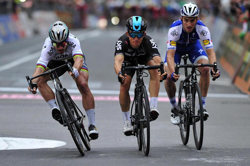 First placed Michal Kwiatkowski, center, crosses the finish line flanked by second placed Peter Sagan, left, and third placed Julian Alaphilippe at the 108th edition of the Milano-Sanremo cycling race from Milan to Sanremo, in Milan, Italy, Saturday, March 18, 2017. (Dario Belingheri/ANSA via AP)