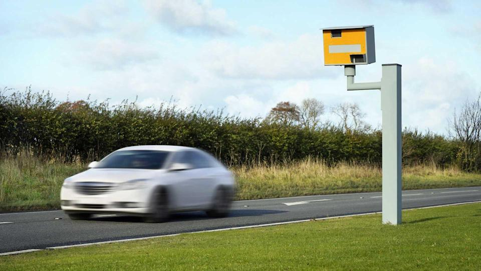 Car drives past speed camera