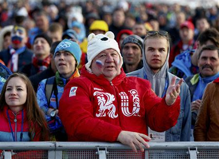 Russian fans watch a broadcast of the men's ice hockey quarter-final match between Russia and Finland in the Olympic Park during the 2014 Winter Olympic Games in Sochi February 19, 2014. REUTERS/Shamil Zhumatov