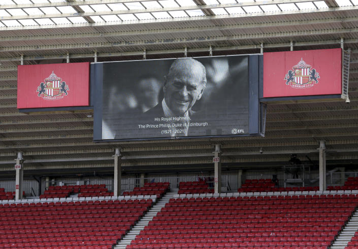 Sunderland and Charlton Athletic players stand for a two minute silence following the death of Britain's Prince Philip, the Duke of Edinburgh yesterday, ahead of the League One soccer match at at the Stadium of Light, Sunderland, England, Saturday April 10, 2021. (Richard Sellers/PA via AP)