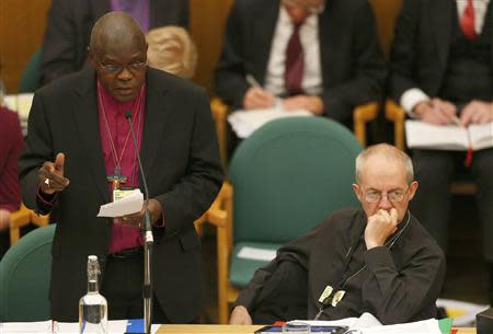 The Archbishop of York, John Sentamu (L), speaks next to the Archbishop of Canterbury Justin Welby at the General Synod in Church House in central London November 20, 2013. REUTERS/Andrew Winning