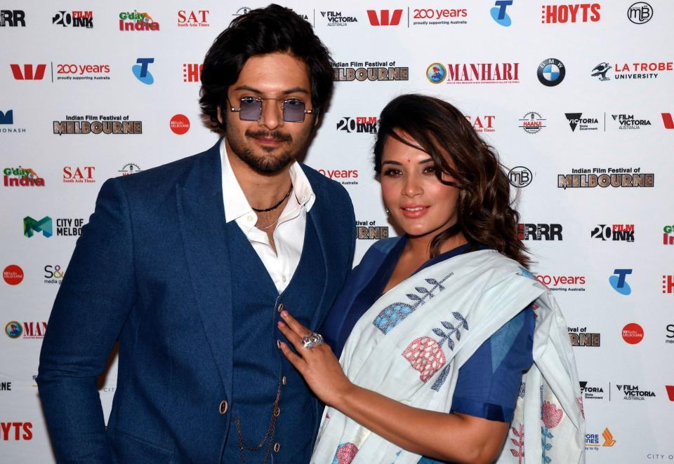 Indian actress Richa Chadha (R) poses for photos with Ali Fazal (L) on the red carpet at the premiere of their movie 'Love Sonia' on the opening night of the Indian Film Festival of Melbourne on August 10, 2018. (Photo by William WEST / AFP)        (Photo credit should read WILLIAM WEST/AFP via Getty Images)
