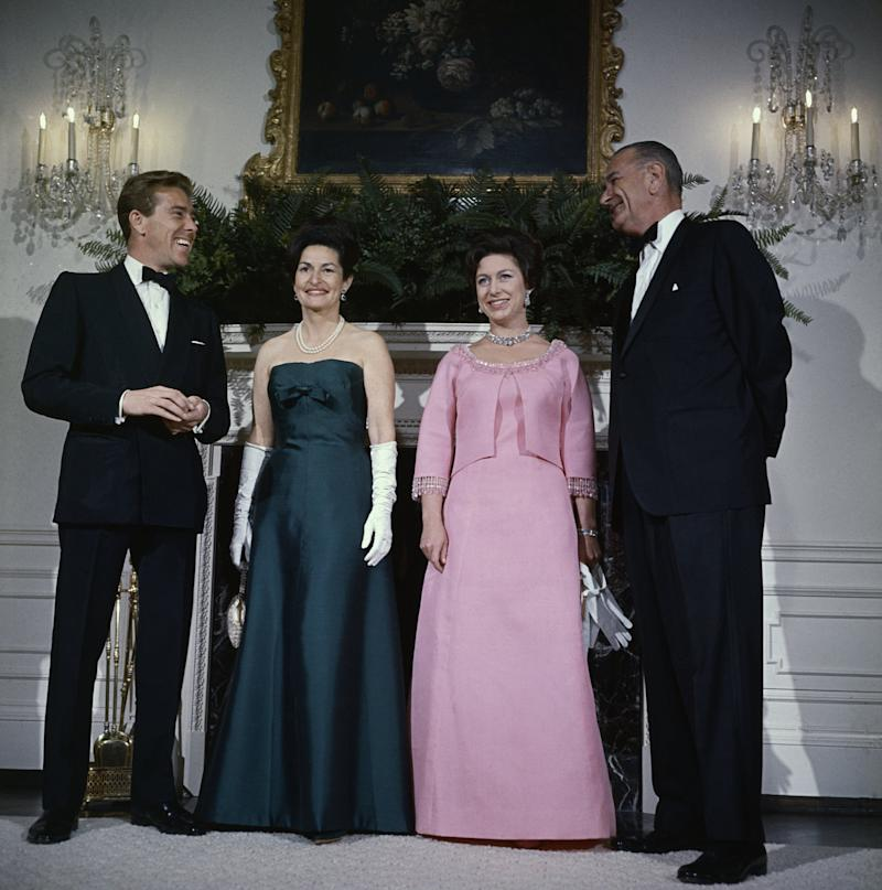 (Original Caption) President Lyndon Johnson (R), Princess Margaret, Mrs. Johnson, and Lord Snowdon pose for photographers in the Queen's room at the White House November 17th, prior to a dinner-dance in honor of the Princess and Lord Snowdon.