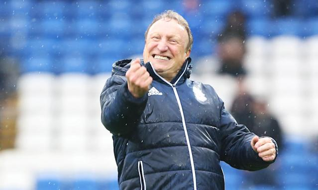 Rain cannot dampen Neil Warnock's mood after Cardiff City's victory against Burton Albion last Saturday.