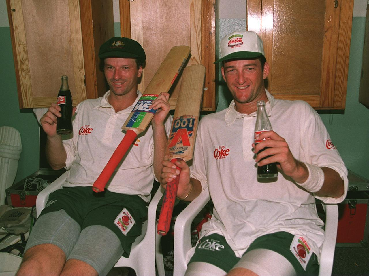 30 APRIL 1995:  AUSTRALIAN BATSMEN MARK WAUGH AND TWIN BROTHER STEVE RELAX IN THE DRESSING ROOM AFTER THEY BOTH MADE THEIR CENTURIES ON THE 2ND DAY OF THE 4TH TEST AGAINST THE WEST INDIES.    Mandatory Credit: Shaun Botterill/ALLSPORT