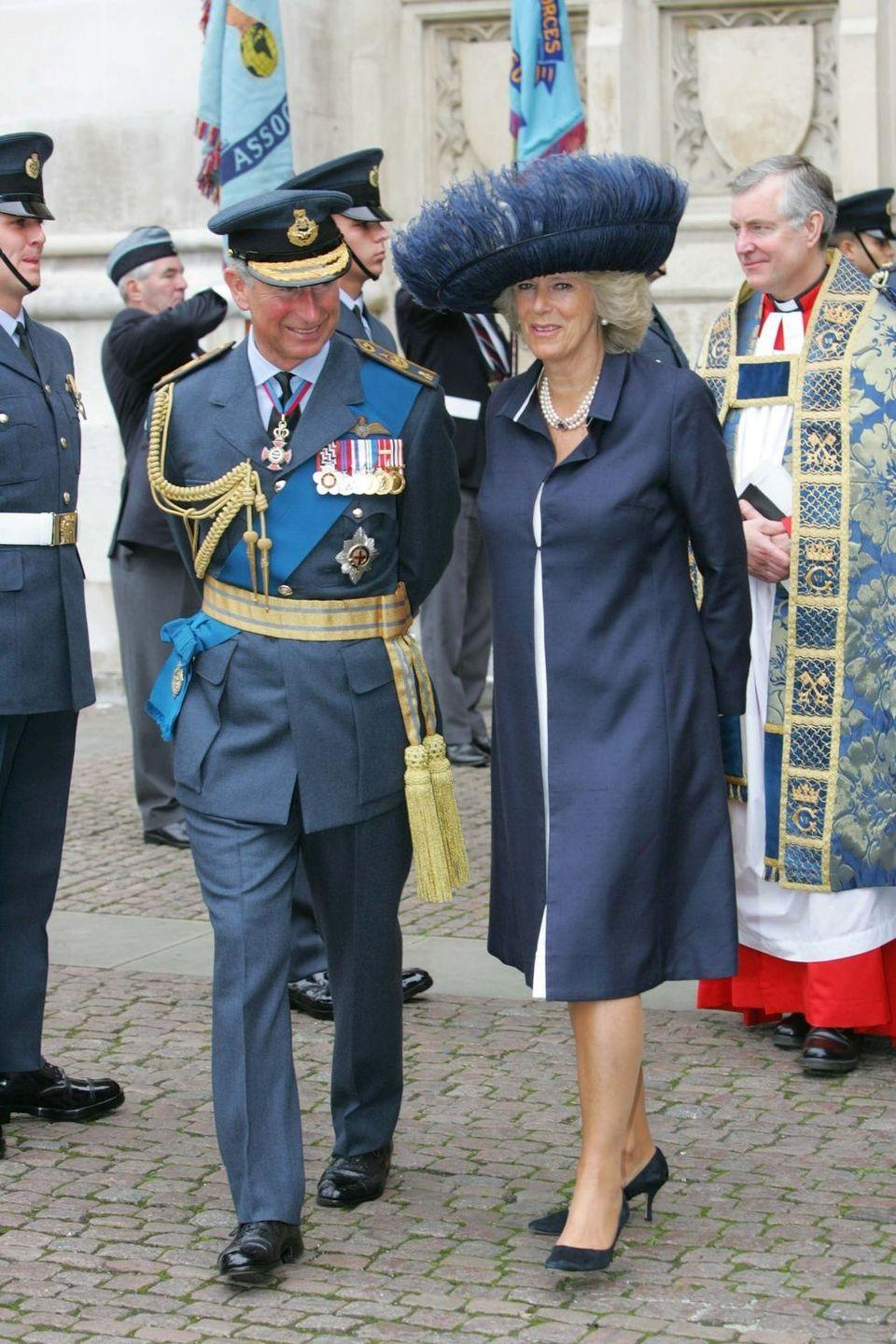 <p>For the commemoration of the 65th anniversary of the Battle of Britain, Camilla wore an elaborate feathered hat in navy with a matching coatdress. </p>