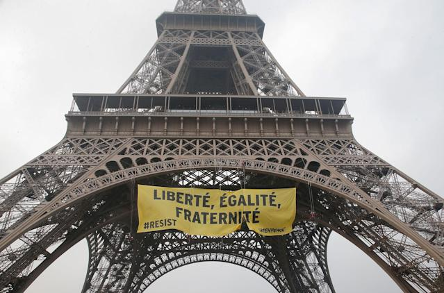 """<p>Greenpeace activists display a banner at the Eiffel tower reads,""""liberty, equality, fraternity"""" in Paris, France, Friday, May 5, 2017. The protest is against far-right presidential candidate Marine Le Pen two days before the runoff. (AP Photo/Michel Euler) </p>"""