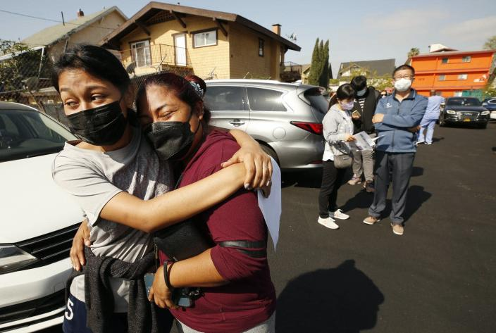 """<span class=""""caption"""">Nothing demonstrates our reliance on each other like a highly contagious disease.</span> <span class=""""attribution""""><a class=""""link rapid-noclick-resp"""" href=""""https://www.gettyimages.com/detail/news-photo/jeymy-mendoza-hugs-her-mother-maria-jimenez-as-they-wait-in-news-photo/1232461504"""" rel=""""nofollow noopener"""" target=""""_blank"""" data-ylk=""""slk:Al Seib/Los Angeles Times via Getty Images"""">Al Seib/Los Angeles Times via Getty Images</a></span>"""