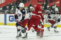 Columbus Blue Jackets center Max Domi (16) checks Detroit Red Wings defenseman Marc Staal (18) in the first period of an NHL hockey game Monday, Jan. 18, 2021, in Detroit. (AP Photo/Paul Sancya)