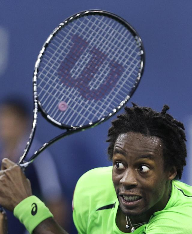Gael Monfils, of France, watches his return to Roger Federer, of Switzerland, during the quarterfinals of the U.S. Open tennis tournament, Thursday, Sept. 4, 2014, in New York. (AP Photo/Charles Krupa)