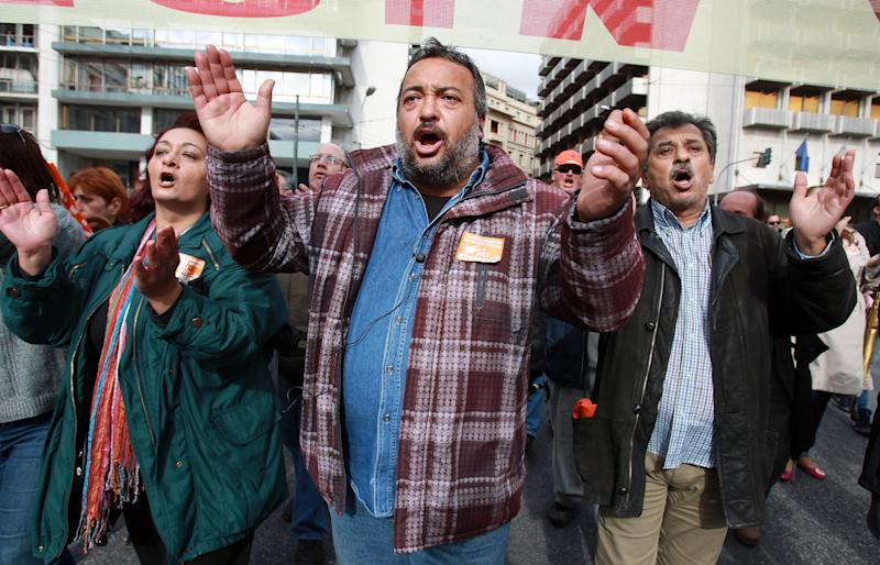 Municipal employees chant slogans during a demonstration organized by their union in Athens, on Tuesday, Nov. 20, 2012. About 2,000 people took part in the protest, against government plans to place 2,000 civil servants on notice ahead of reassignment or potential dismissal. Greece faces a tense wait Tuesday for vital bailout money as finance ministers from the 17 European Union countries that use the euro try to reach an agreement on how to put the country's economic recovery back on the right track. (AP Photo/Thanassis Stavrakis)