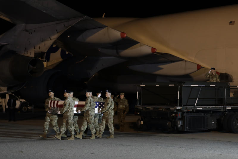 A U.S. Army carry team moves a transfer case containing the remains of Chief Warrant Officer 2 Kirk T. Fuchigami Jr. of Keaau, Hawaii, Thursday, Nov. 21, 2019, at Dover Air Force Base, Del. According to the Department of Defense, Fuchigami died in Afghanistan when his helicopter crashed while providing security for troops on the ground in eastern Logar Province. (AP Photo/ Evan Vucci)