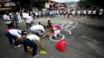 Protesters in Colombia pay tribute to those killed during recent anti-government protests