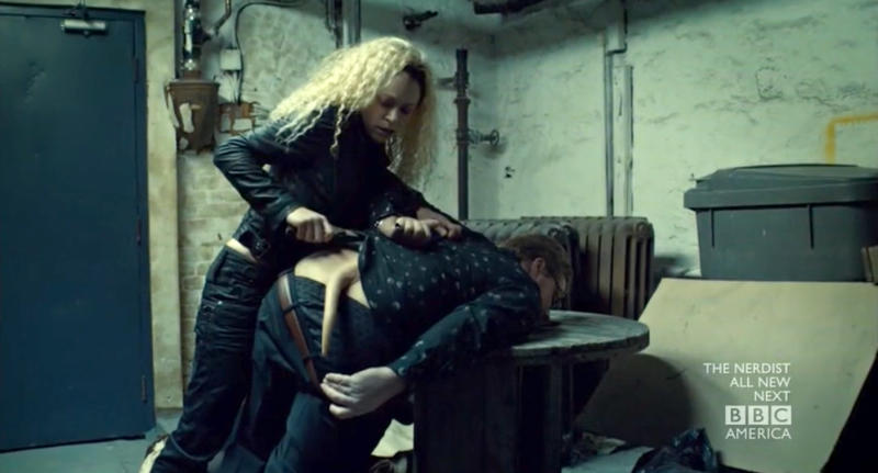 Helena cuts off Olivier's tail.