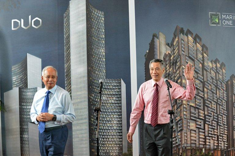 Singapore's Prime Minister Lee Hsien Loong (right) and Malaysia's Prime Minister Najib Razak (left) attend the Marina One unveiling ceremony in Singapore on February 19, 2013. Singapore and Malaysia announced plans Tuesday to build a high-speed rail link, fuelling hopes that Southeast Asia could one day enjoy a rapid European-style train system connected to China