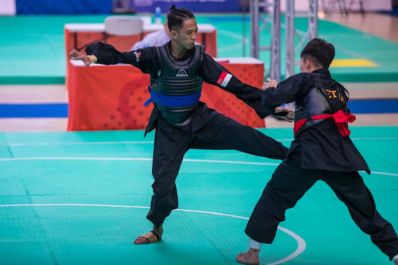 Singapore silat athlete Muhammad Hazim Mohamad Yusli en route to winning a SEA Games gold in the men's Tanding Class B final. (PHOTO: Sport Singapore/Dyan Tjhia)