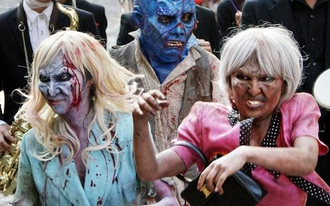 Participants march in the annual Halloween parade in Kawasaki near Tokyo in 2009 - Credit: Koji Sasahara/AP