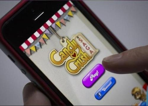 Phone displaying Candy Crush screen