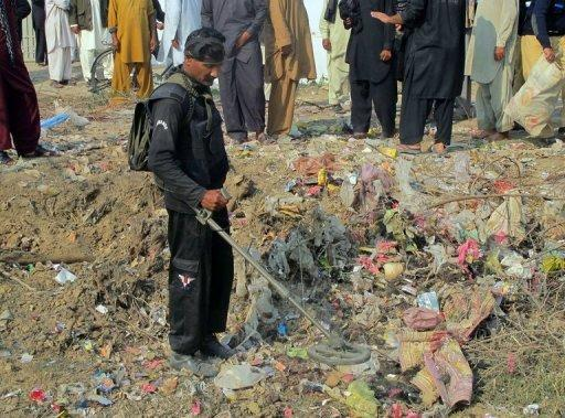 A bomb disposal expert checks the site of a bomb explosion at Dera Ismail Khan in Khyber Pakhtunkhwa province on Saturday. A bomb blast claimed by the Taliban killed eight people near a Shiite Muslim procession in northwest Pakistan on Saturday, in the latest attack against the minority during their holy month