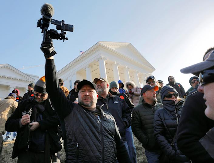 American radio host Alex Jones films the crowd inside the no-gun zone during a gun rights rally in front of the Virginia State Capitol building, in Richmond, Virginia, U.S. January 20, 2020. REUTERS/Jonathan Drake (Photo: Jonathan Drake / Reuters)