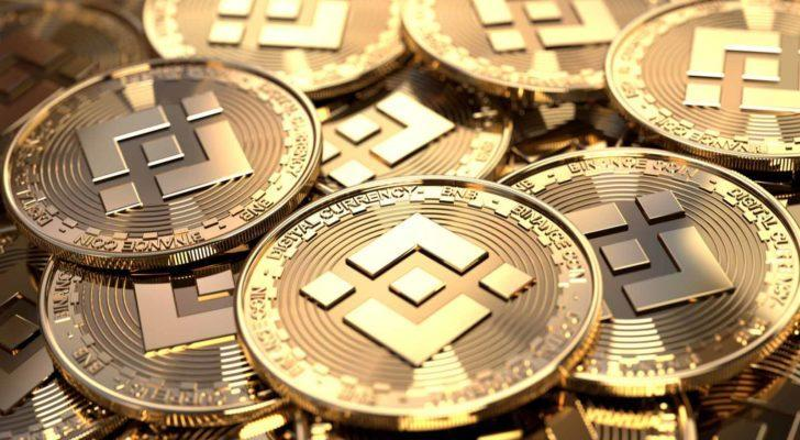 Binance (BNB-USD) logo displayed on a pile of altcoins