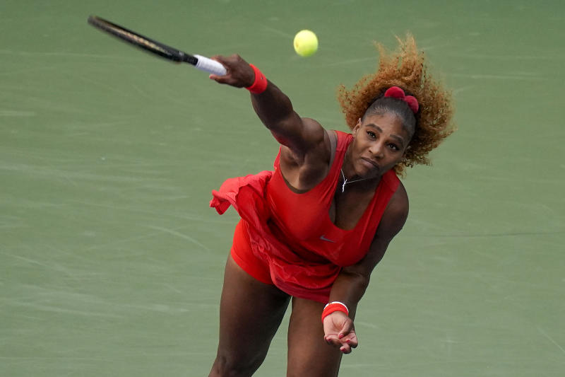Serena Williams, of the United States, serves to Sloane Stephens, of the United States.