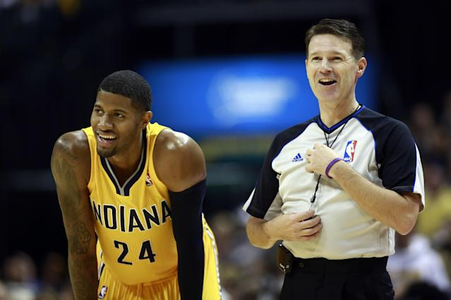 Indiana Pacers forward Paul George (24) laughs with an official in the second half of an NBA basketball game against the Orlando Magic in Indianapolis, Tuesday, Oct. 29, 2013. The Pacers won 97-87. (AP Photo/R Brent Smith)