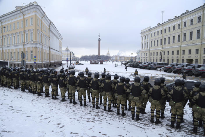 Russian Rosguardia (National Guard) soldiers stand toward the Palace Square a day before of Sunday's protest in St. Petersburg, Russia, Saturday, Jan. 30, 2021. As part of a multipronged effort by the authorities to discourage Russians from attending Sunday's demonstrations, the Prosecutor General's office ordered the state communications watchdog, Roskomnadzor, to block the calls for joining the protests on the internet. The Prosecutor General's office and the Interior Ministry also issued stern warnings to the public not to join the protests, saying participants could face criminal charges of taking part in mass riots if the rallies turn violent. (AP Photo/Ivan Petrov)