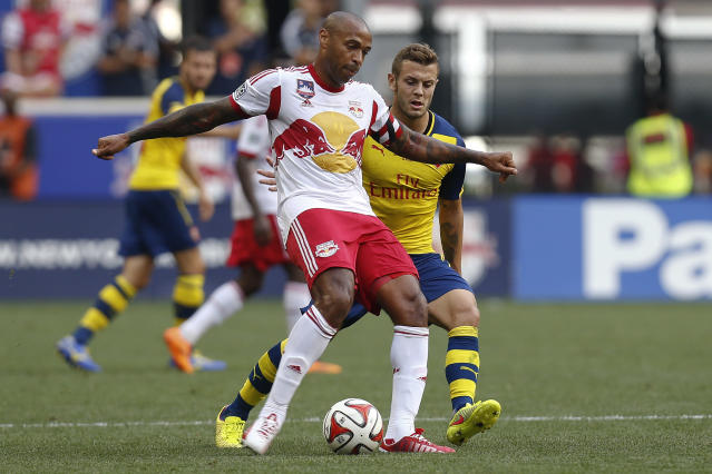 Thierry Henry of New York Red Bulls clears the ball in font of Arsenal's Jack Wilshere during their friendly match at Red Bull Arena on July 26, 2014 in Harrison, NJ (AFP Photo/Jeff Zelevansky)
