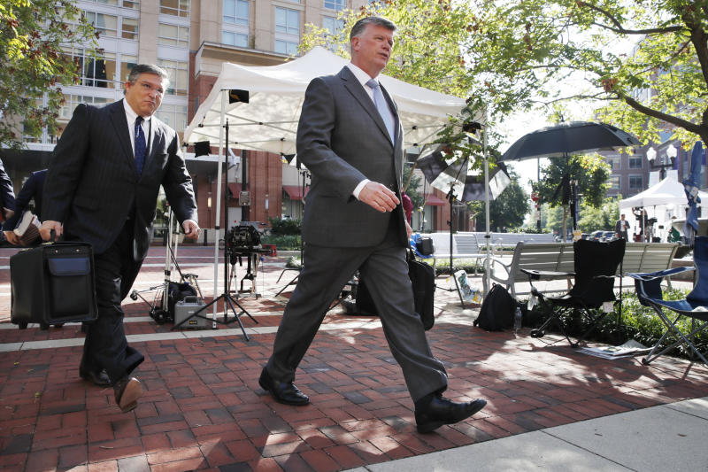 The defense team for former Trump campaign chairman Paul Manafort, including Kevin Downing, right, walk past television equipment as they arrive at federal court for the continuation of Manafort's trial, in Alexandria, Va., Thursday, Aug. 9, 2018. (AP Photo/Jacquelyn Martin)