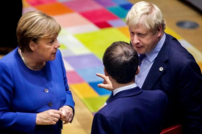 British Prime Minister Boris Johnson, French President Emmanuel Macron and German Chancellor Angela Merkel, seen here speaking at a European summit in Brussels in October 2019, have all congratulated US President-elect Joe Biden