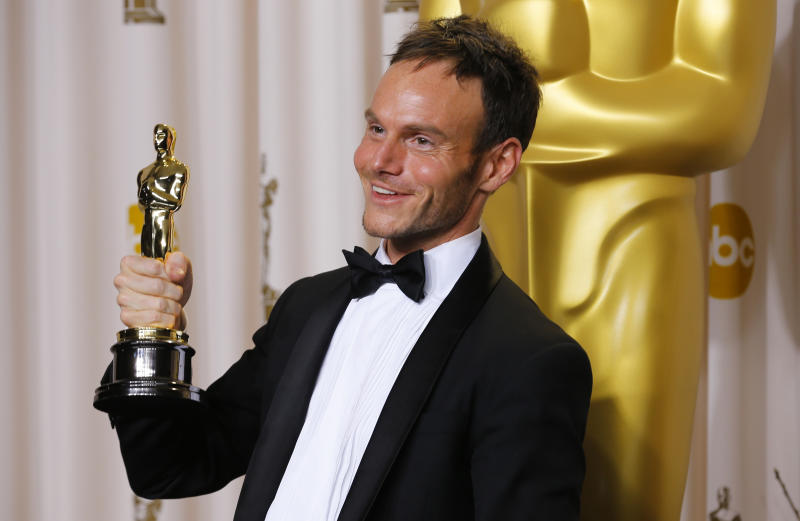 "Chris Terrio, best adapted screenplay winner for the film ""Argo,"" poses with his Oscar backstage at the 85th Academy Awards in Hollywood, California, February 24, 2013. REUTERS/Mike Blake (UNITED STATES - Tags: ENTERTAINMENT) ) (OSCARS-BACKSTAGE)"