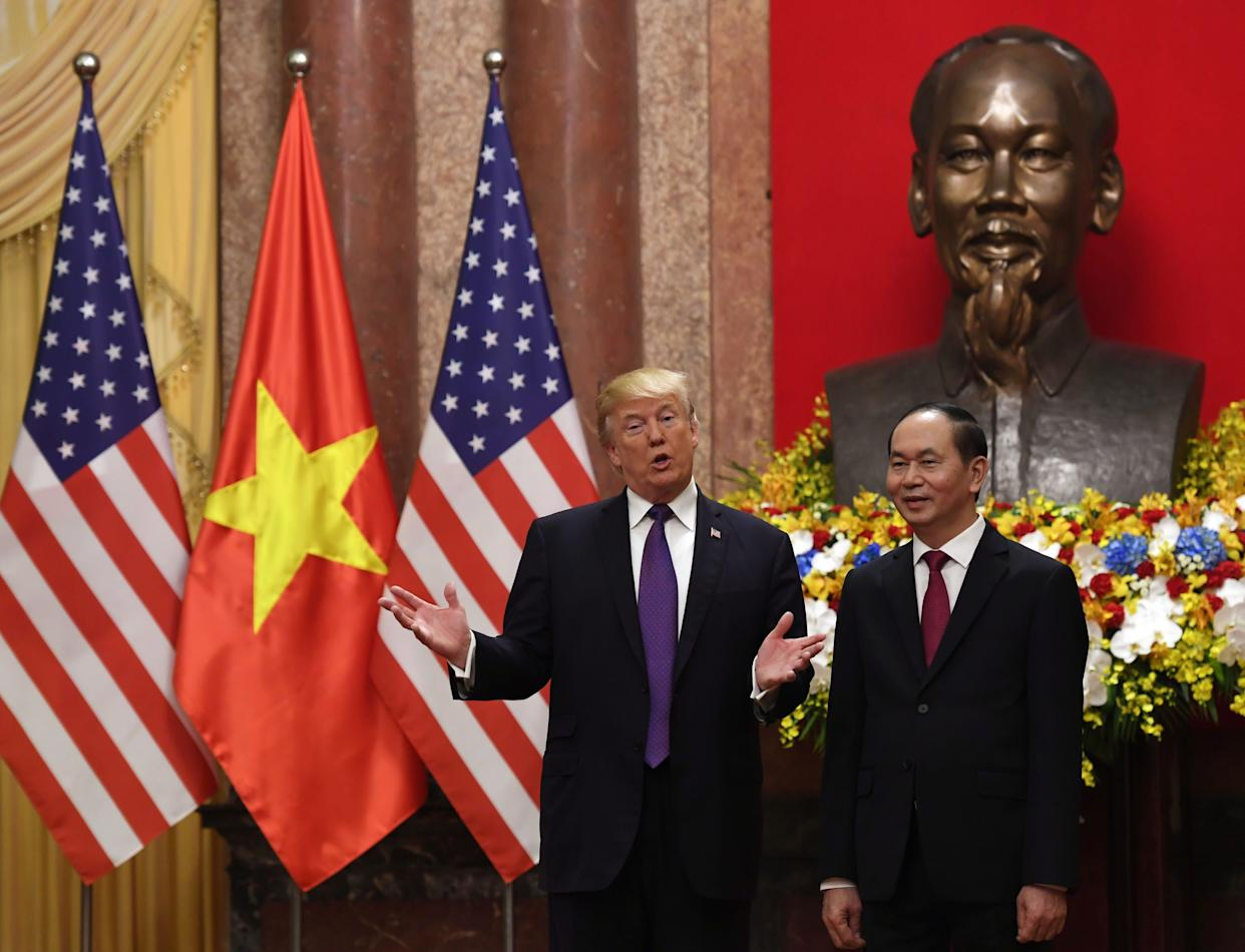 U.S. President Donald Trump poses with VietnamesePresident Trần Đại Quang during a welcoming ceremony at the Presidential Palace in Hanoi on Nov. 12, 2017. (Photo: Hoang Dinh Nam / Pool / Reuters)