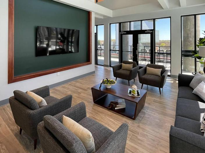 A large seating area offers a gathering spot near the TV.