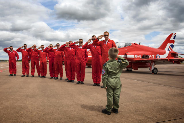 Jacob Newson, five, takes a salute from his heroes the Red Arrows pilots, at the Royal International Air Tattoo at RAF Fairford (Picture: UK MOD/Crown 2019)