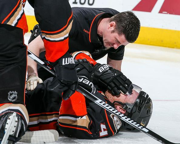 ANAHEIM, CA - APRIL 4: Athletic trainer Joe Huff of the Anaheim Ducks examines Cam Fowler #4 after a hit during the third period of the game against the Calgary Flames at Honda Center on April 4, 2017 in Anaheim, California. Fowler was helped off the ice after the examination. (Photo by Debora Robinson/NHLI via Getty Images) ***Local Caption ***
