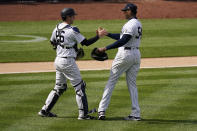 New York Yankees relief pitcher Aroldis Chapman, right, celebrates with catcher Kyle Higashioka after a baseball game against the Detroit Tigers at Yankee Stadium , Sunday, May 2, 2021, in New York. (AP Photo/Seth Wenig)