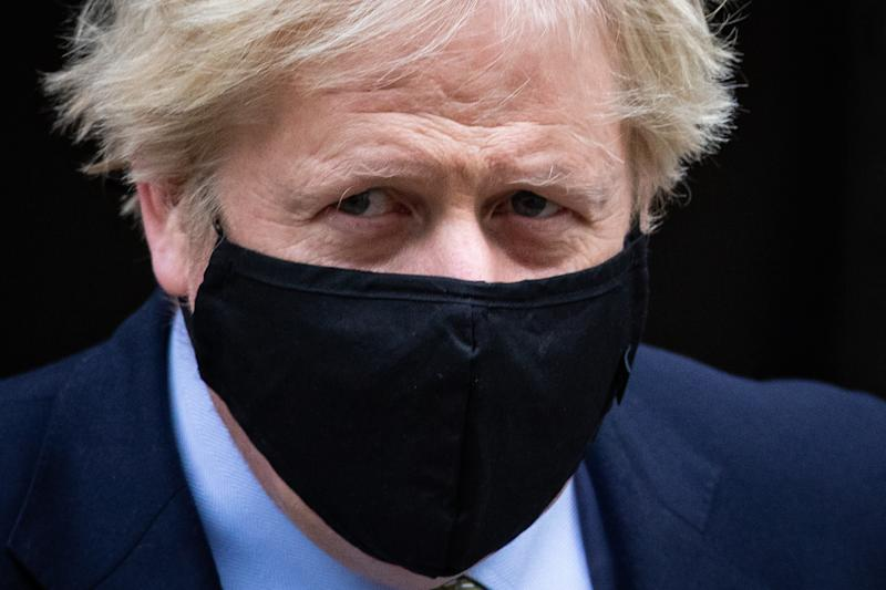 Prime Minister Boris Johnson leaves 10 Downing Street to attend Prime Minister's Questions, at the Houses of Parliament, London. (Photo by Aaron Chown/PA Images via Getty Images)