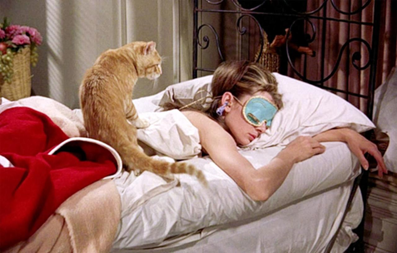 <p>Audrey Hepburn catches some zzz's as Holly Golightly in <em>Breakfast at Tiffany's</em>. The world suddenly realizes that sleep accessories can be fiercely chic.</p>