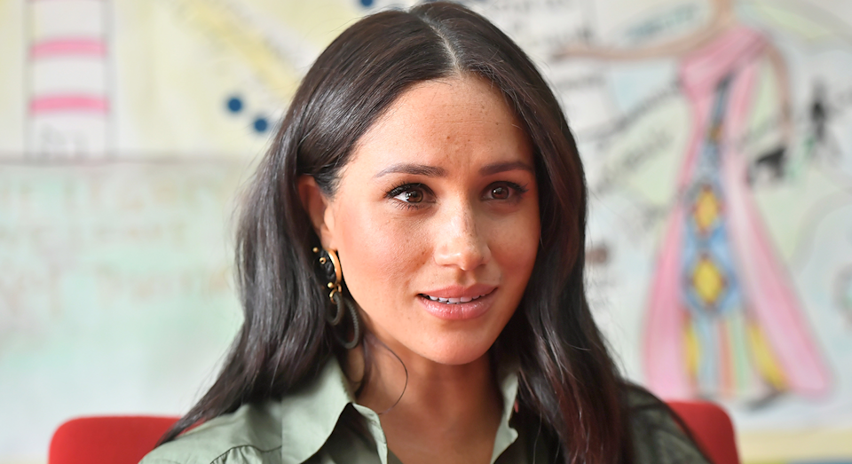 Meghan changed into her second look of the day to visit Action Aid. [Photo: Getty]