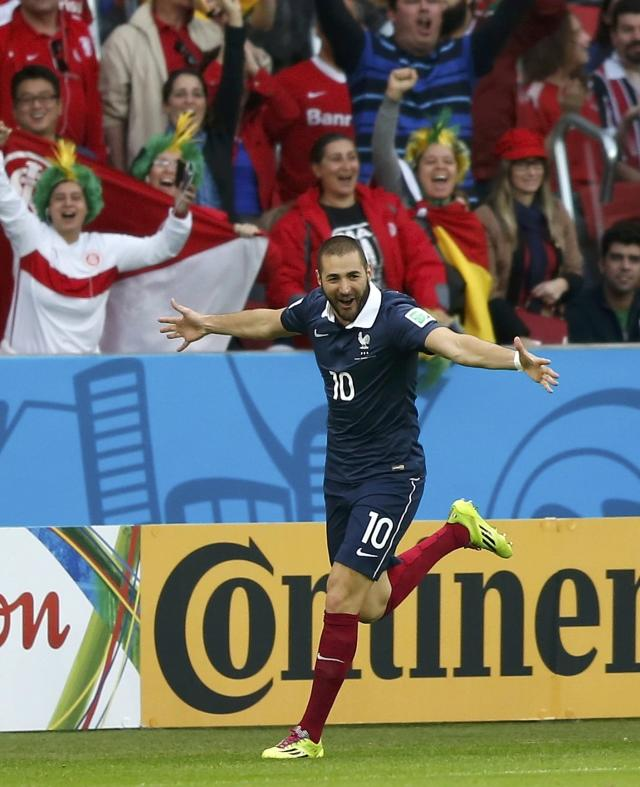 France's Karim Benzema celebrates scoring his second goal against Honduras during their 2014 World Cup Group E soccer match at the Beira-Rio stadium in Porto Alegre June 15, 2014. REUTERS/Edgard Garrido (BRAZIL - Tags: SOCCER SPORT WORLD CUP)
