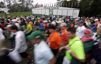 Spectators make their way to the course before the final round of the Masters golf tournament Sunday, April 12, 2015, in Augusta, Ga. (AP Photo/Charlie Riedel)