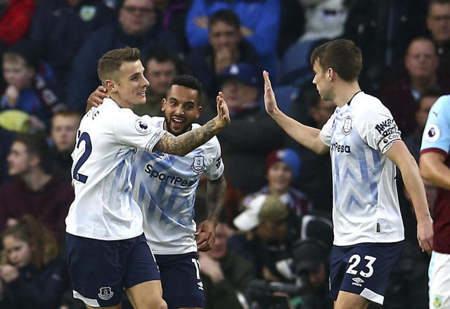 Everton's Lucas Digne, left, celebrates scoring his side's second goal of the game with team mates during the English Premier League soccer match between Burnley and Everton at Turf Moor, in Burnley, England, Wednesday, Dec. 26, 2018. (Dave Thompson/ PA via AP)