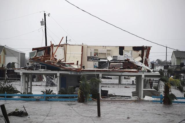 <p>A damaged home is seen after Hurricane Harvey passed through on August 26, 2017 in Rockport, Texas. (Photo: Joe Raedle/Getty Images) </p>