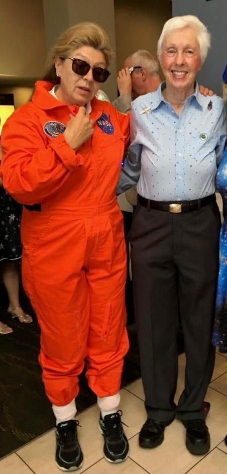 Picture of Virgin Galactic ticket holder next to Wally Funk