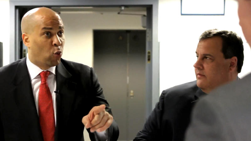 In an image made from video provided by Gov. Chris Christie's office, New Jersey Gov. Chris Christie, right, and Newark Mayor Cory Booker perform in a video parody that spoofs the mayor's heroics and Christie's vice presidential potential. The video played Tuesday, May 15, 2012 at the New Jersey Press Association's Legislative Correspondents Club show. (AP Photo/Gov. Chris Christie's office)