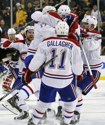 Montreal Canadiens teammates celebrate with P.K. Subban (76) after his game-winning goal in the second overtime period against the Boston Bruins in Game 1 of an NHL hockey second-round playoff series in Boston, Thursday, May 1, 2014. The Canadiens won 4-3. (AP Photo/Elise Amendola)